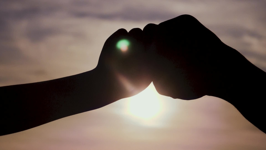 Teamwork concept. of a human hand with bumping fist. Friends Friendship Fist Bump Togetherness Concept. father and son teamwork hands lifestyle silhouette at sunset | Shutterstock HD Video #1042983073