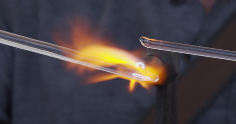 Glass work with flame. Slow motion close up of glass statuary shaping with flame on a handmade in workshop. Concept of handmade, high quality, glass blower work | Shutterstock HD Video #1044348493