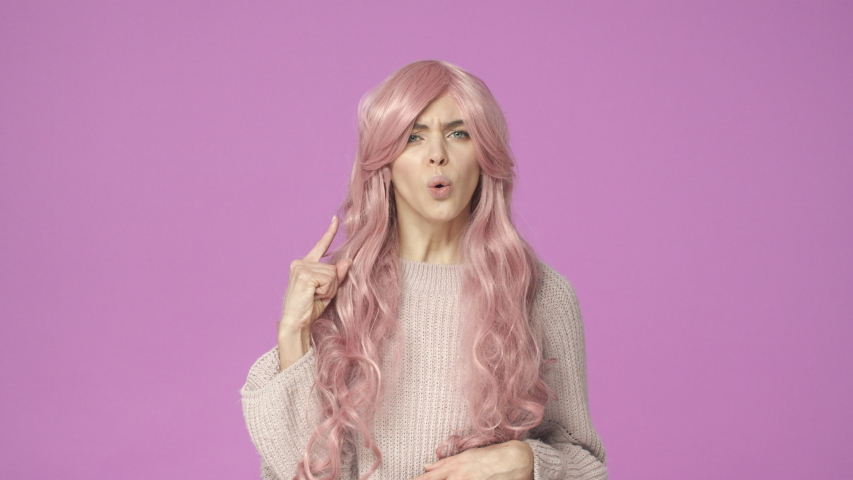 Slow-motion serious-looking displeased female in pink kawaii wig talking, having intense conversation, shake head in refusal, saying no, shaking hands, making stop gesture, rejecting, being reluctant | Shutterstock HD Video #1044719413