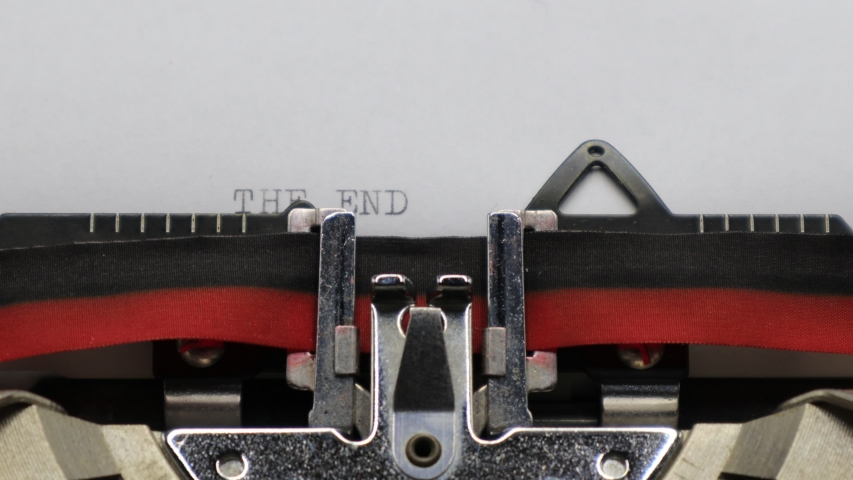 Typing THE END with an old vintage Typewriter   Shutterstock HD Video #1044787573