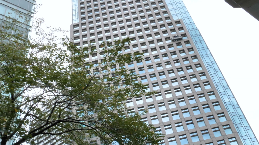 A view of the tall high rise building in Tokyo Japan while cruising along the river | Shutterstock HD Video #1044891313