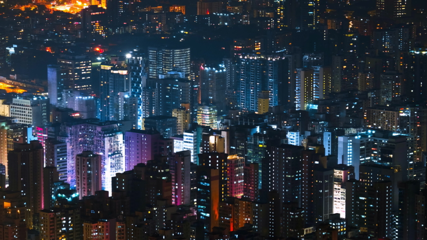 Abstract cityscape of Hong Kong. Futuristic view of illuminated skyscrapers at night. Popular tourist attraction. Modern architecture, towers and high buildings of asian metropolis. Time lapse   Shutterstock HD Video #1044910333