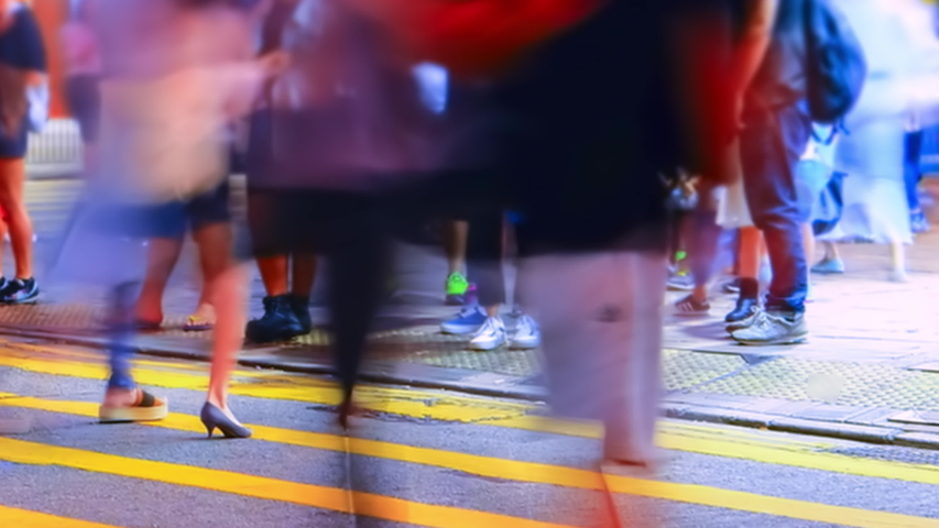 Pedestrians going on crosswalk in Hong Kong in evening. Buildings and skyscrapers illuminated at night. Busy life of asian metropolis with traffic. Tilt shift lens and blur effect. Time lapse   Shutterstock HD Video #1044910363