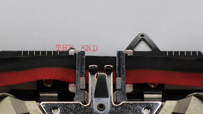 Typing THE END with an old vintage Typewriter   Shutterstock HD Video #1044933433