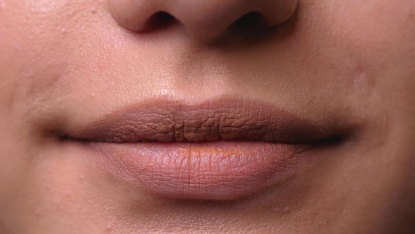Girl's lips close up, air kiss | Shutterstock HD Video #1044957583