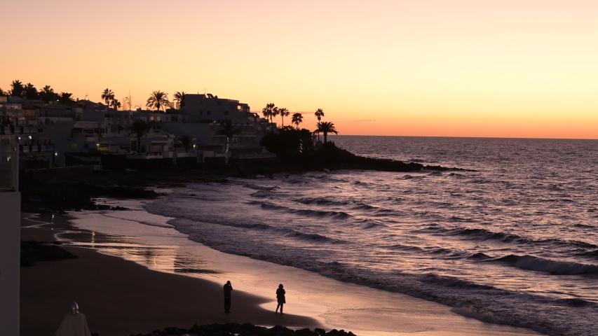 Sunrise over a holiday beach | Shutterstock HD Video #1045033603