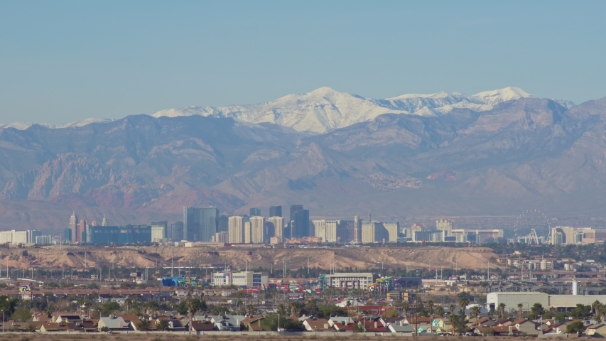 Morning view of the famous Las Vegas Strip skyline with mountain behind at Nevada | Shutterstock HD Video #1045069483