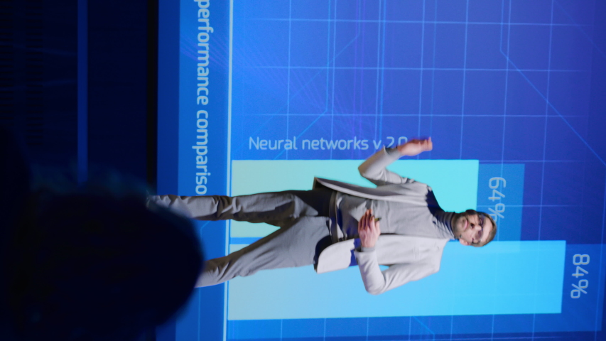 Live Event Stage: Speaker Presents New Product, Screen SHows Neural Networks, Artificial Intelligence, Big Data and Machine Learning. Video with Vertical Screen Orientation 9:16 | Shutterstock HD Video #1045102453
