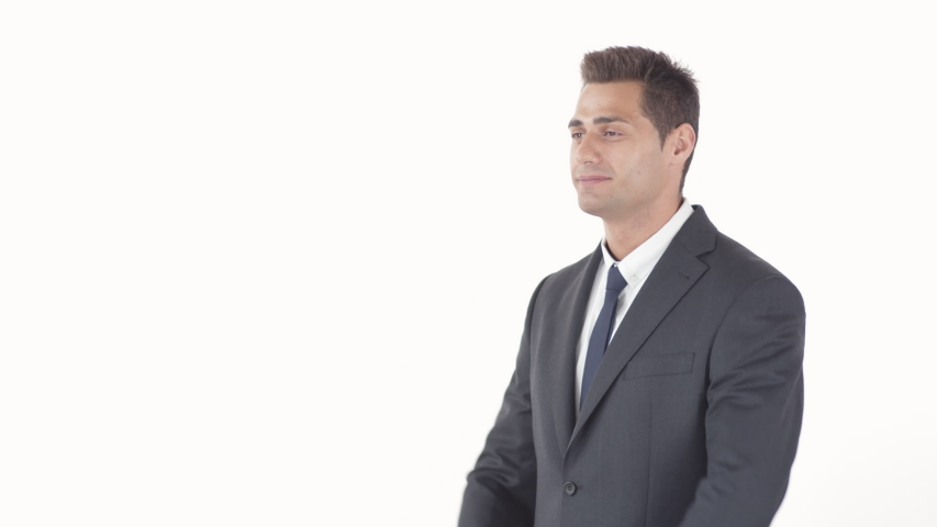 Medium shot of confident mixed-race man wearing elegant suit crossing arms on his chest and then looking at camera on white background | Shutterstock HD Video #1045219993