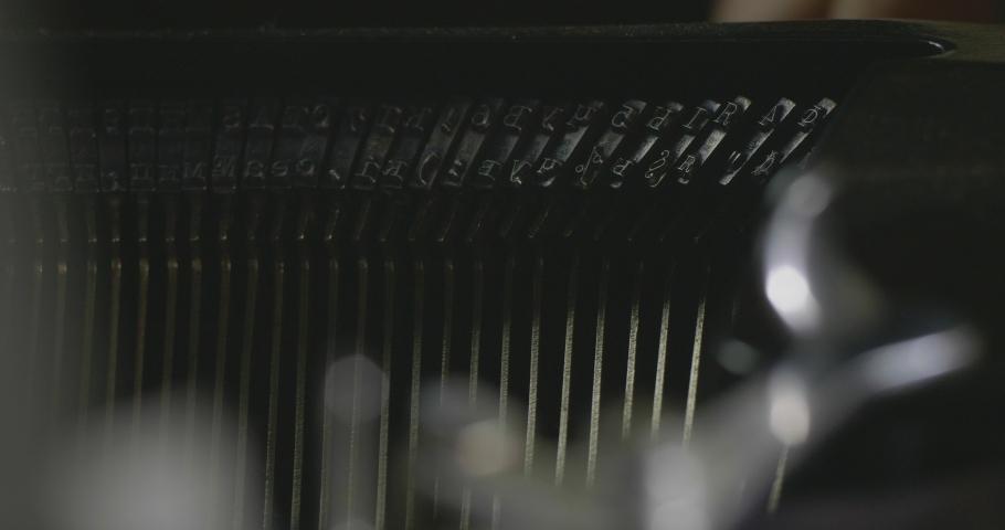 Typing Keys On Inside Of Vintage Typewriter. Close Up Keys Hitting The Paper While Typing In An Old Typewriter. Macro Shot. Cinema 4K Video | Shutterstock HD Video #1045227493