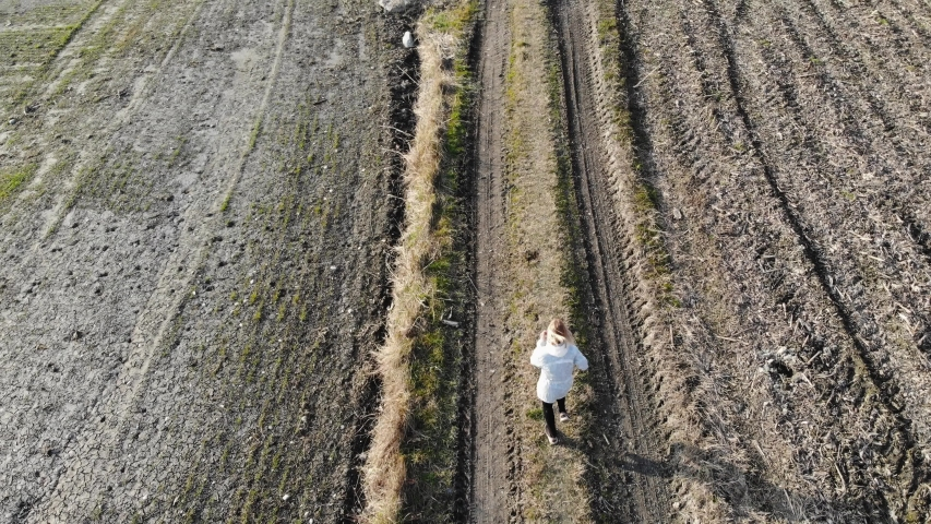 Woman Running in the Wild, Aerial View | Shutterstock HD Video #1045305913