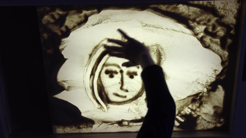 Sand animation. Child drawing sand on a white screen with hands | Shutterstock HD Video #1045396273