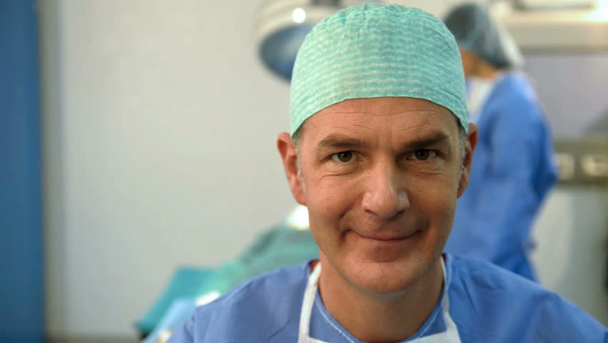 Portrait of A Smiling    Male Surgeon; HD Photo JPEG, dolly.
