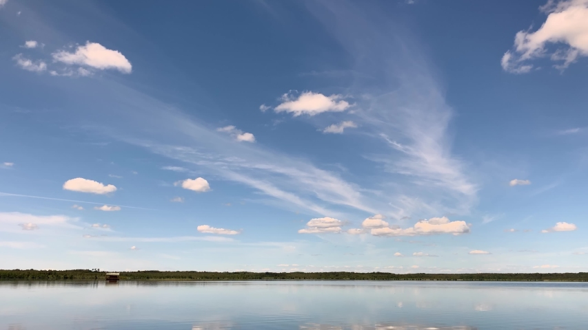 The Beautiful And Calm Lielauces Lake In Latvia On A Bright Sunny Day - Timelapse Wide Shot | Shutterstock HD Video #1045449883
