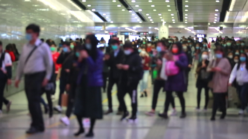Blurred masked people with motion in Hong Kong  | Shutterstock HD Video #1045863013