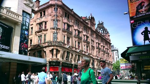 LONDON, ENGLAND - MAY 30, 2015: Centre London Cinema and Shopping Street in Leicester Square Theatreland in London People Walk Visit ( Ultra High Definition, Ultra HD, UHD, 4K, real time )