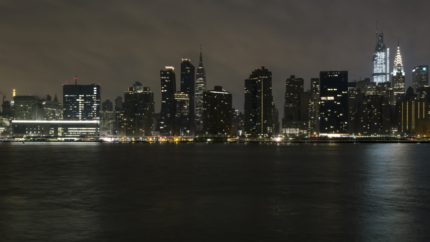 Midtown Manhattan Coastline from east river night to day timelapse | Shutterstock HD Video #1046098963
