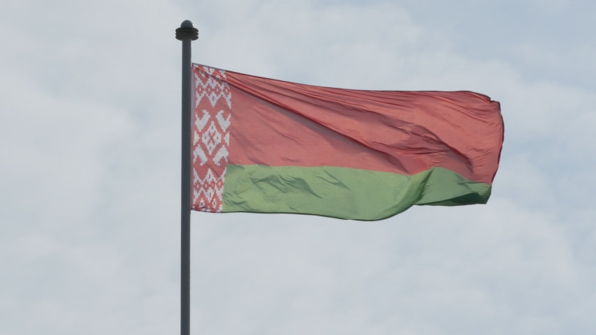 Ungraded: The national flag of the Republic of Belarus flutters on a flagpole against blue summer sky. Ungraded H.264 from camera without re-encoding. | Shutterstock HD Video #1046181853