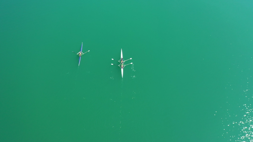 Kayaking with people on turquoise water.  Aerial view | Shutterstock HD Video #1046408053