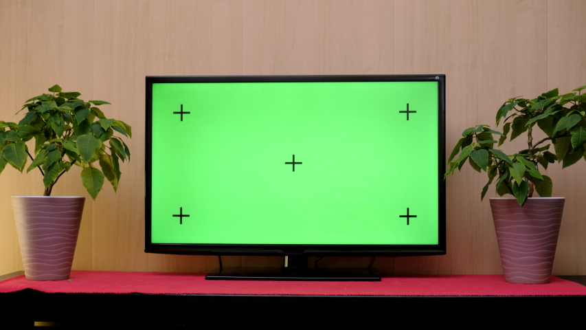 TV with green screen composited. TV or television - green screen - room - on the table. LCD TV with track green screen in modern livingroom | Shutterstock HD Video #1046797543