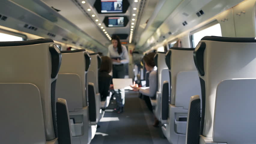 Businesspeople working in the public train, steadycam shot