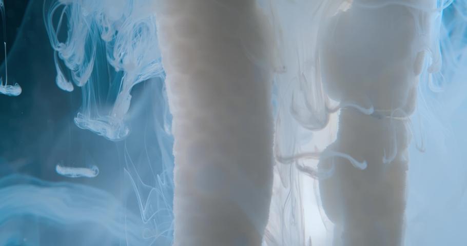 White  Fluid  in Motion underwater. Macro.  Liquids Threads. | Shutterstock HD Video #1046871253