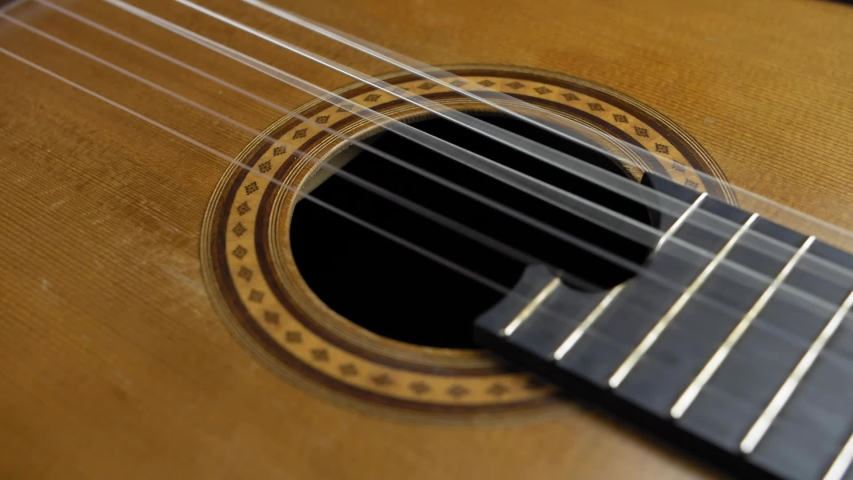 Classical Guitar Strings Vibrating when Song is Played Slow Motion | Shutterstock HD Video #1046957503