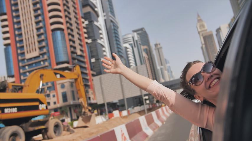 Happy girl travels by car in Dubai. | Shutterstock HD Video #1046983813