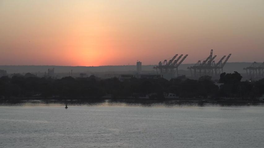 Harbor cranes at dawn. Transport technology. | Shutterstock HD Video #1047081373