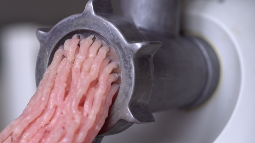 Machine Mincing Grind Meat for Cooking. Preparing meat dish. Fresh raw minced turkey | Shutterstock HD Video #1047113173
