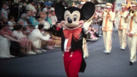 DISNEYLAND, CALIFORNIA. USA - JUNE 1968 The street parade where all you favorite Disney characters come out to greet awaiting fans.