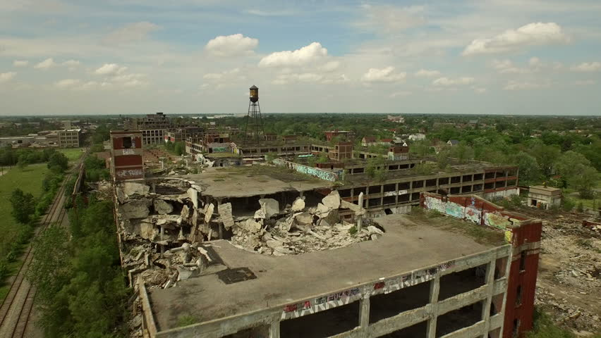 Detroit Aerial v63 Flying low over abandoned old Packard Plant then panning left.