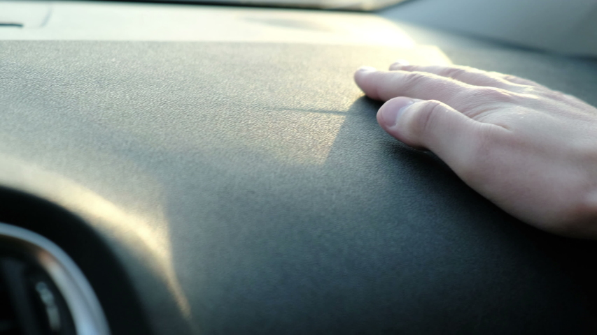 Male hand touching atrial dashboard of a car, closeup. Ergonomics and comfort in the car   Shutterstock HD Video #1049157253