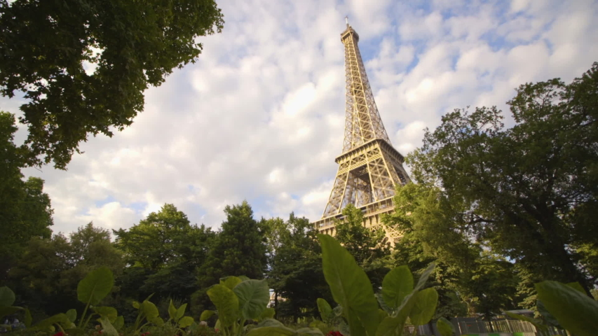 Eiffel Tower with Leaves in Foreground | Shutterstock HD Video #1049322943