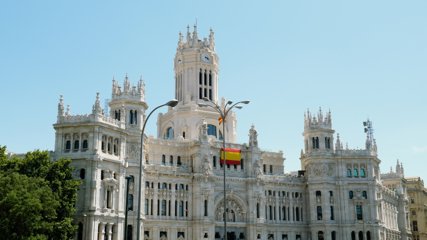 Exterior view of Palace of Communications. Facade of Cibeles Palace located in centre of Madrid. Spain. 4K | Shutterstock HD Video #1049590543