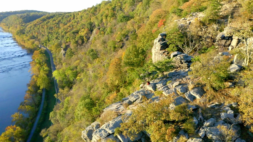 Couple Sitting on Cliff Above Harpers Ferry, West Virginia, Aerial View | Shutterstock HD Video #1049616373