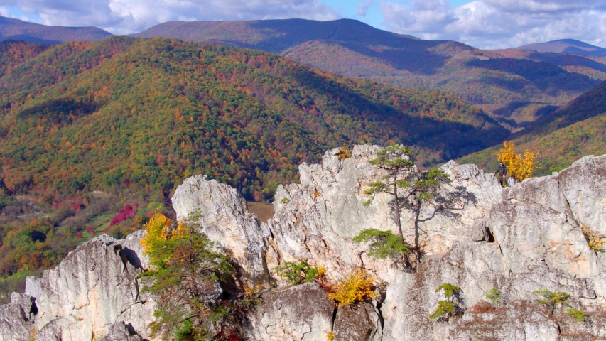 Couple Hiking at Top of Seneca Rocks Peak, West Virginia, Aerial View | Shutterstock HD Video #1049616493