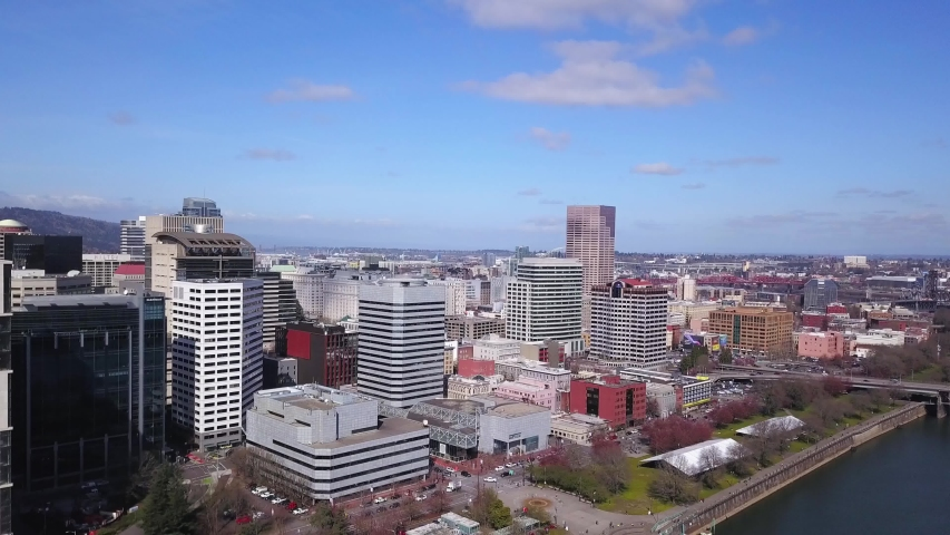 Aerial flying towards and descending over downtown Portland Oregon city office buildings. | Shutterstock HD Video #1049623033