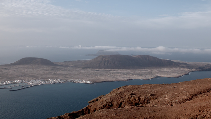 The sea and horizon at La Graciosa, an island in the Canaries. | Shutterstock HD Video #1049623693