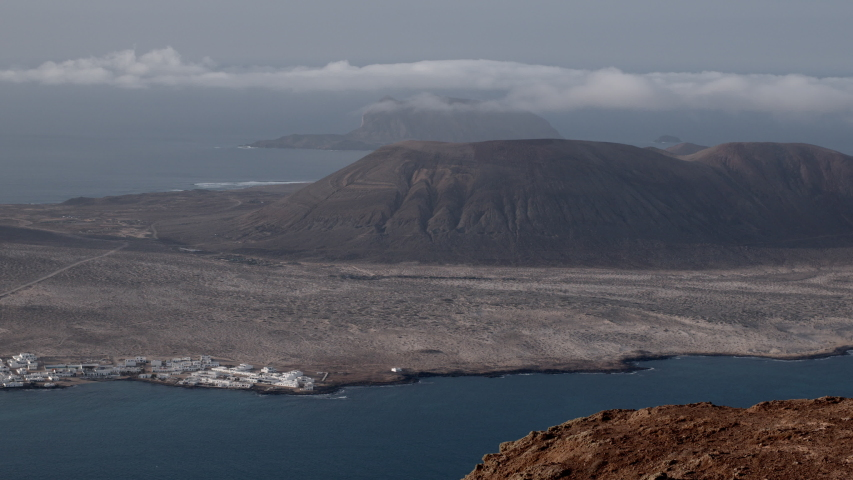 The sea and horizon at La Graciosa, an island in the Canaries. | Shutterstock HD Video #1049632033