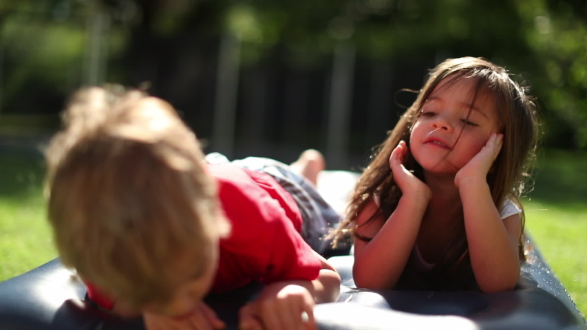 Cute children together outside. Baby brother and sisters in outdoor garden | Shutterstock HD Video #1049718973