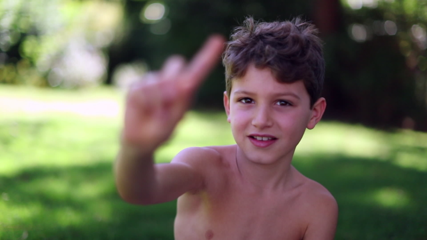 Child shaking finger outdoors. Young boy saying NO gesture | Shutterstock HD Video #1049719033