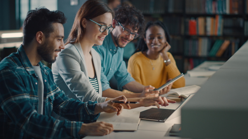 University Library: Diverse Group of Equally Gifted Students Have Discussion, use Laptop, Prepare for Exams Together, Helping, Researching Subjects for the Paper Assignment. Happy Young People Study | Shutterstock HD Video #1049866993