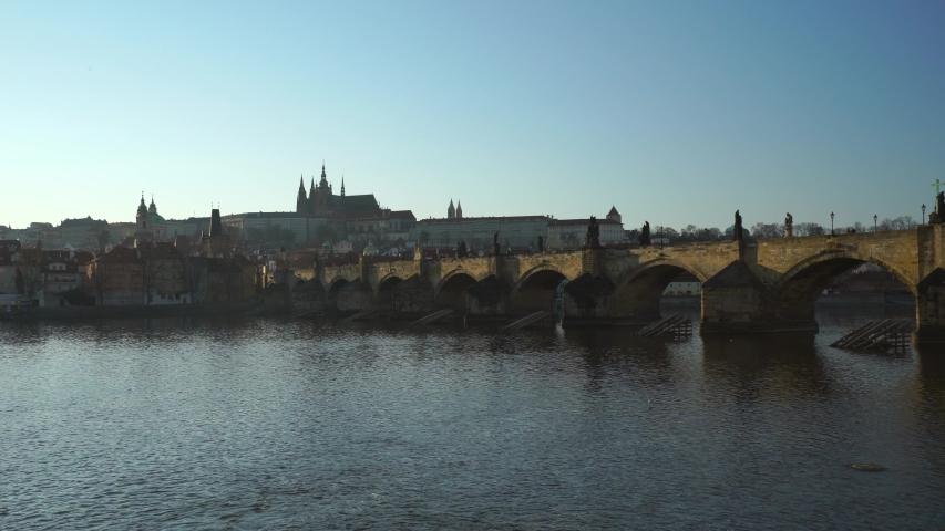 Prague Castle and Charles bridge with Vltava river in Prague Czech Republic. Pan movement, 4K video of Czechia historical symbols. | Shutterstock HD Video #1050036703
