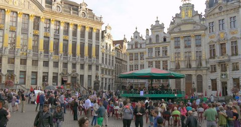 BRUSSELS BELGIUM 14 SEP 2014: European Brussels city Grand place square Town hall, Belgium. Tourist crowd people walk Grand Place city hall Brussels, Belgium. Europe Bruxelles Brussels Belgium skyline