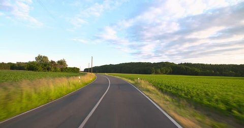 Driving a car - POV - Country Road Shot on roof-mounted Sony PXW FS7 This shot was split into a series of takes, that can be put back together for the original length clip.