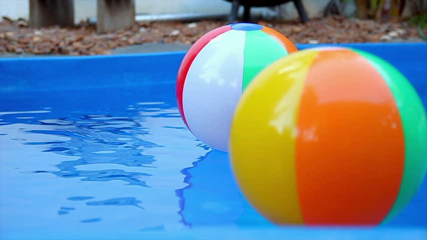 Pool Water With Beach Ball colorful beach ball floating in pool stock footage video 4752698