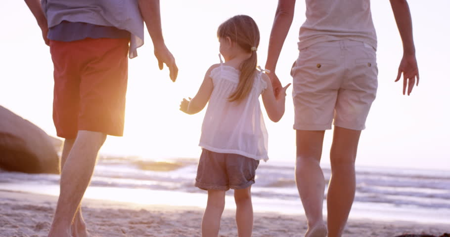 Happy family on the beach holding hands swinging little girl around at sunset on vacation slow motion RED DRAGON | Shutterstock HD Video #10528412