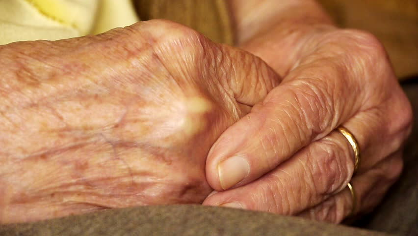 Senior old woman young man hold hand wrinkle skin close up   | Shutterstock HD Video #1053133