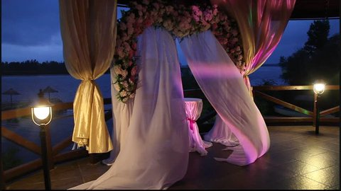 Arch for wedding ceremony, the curtain in the wind